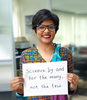 Headshot of Senjuti Saha holding a sign reading Science by and for the many, not the few.