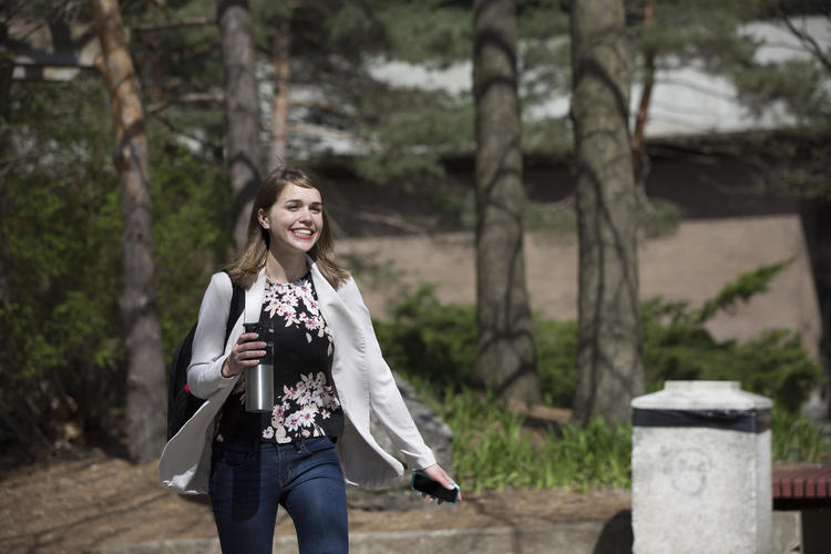 Student walking through campus