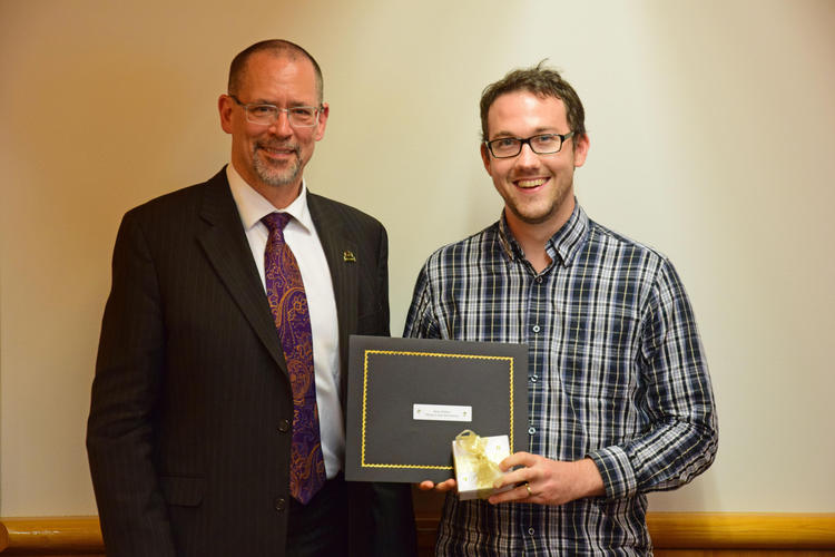 Graduate student receiving an award