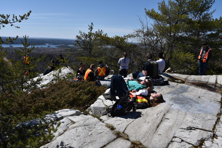 Students on geological feature