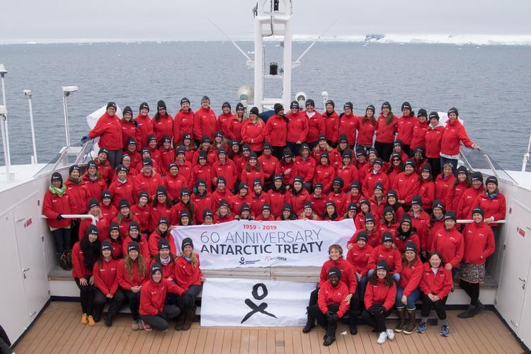 Homeward Bound 4 cohort with Antarctic treaty flag