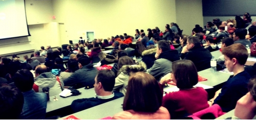 Prospective high school students and parents listening to a presentation