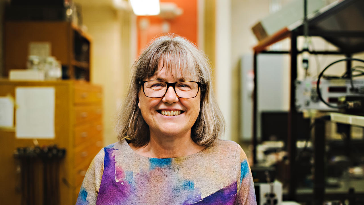 Smiling portrait of Donna Strickland in her lab