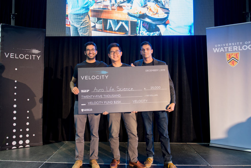 Keean Sarani, Jiwoo Jang and Shak Lakhani holding their winning cheque.