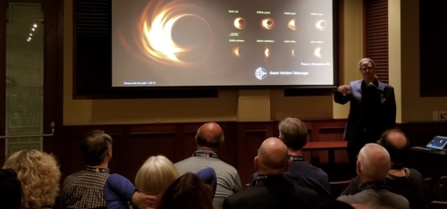 Avery Broderick presents images of black holes to a audience.