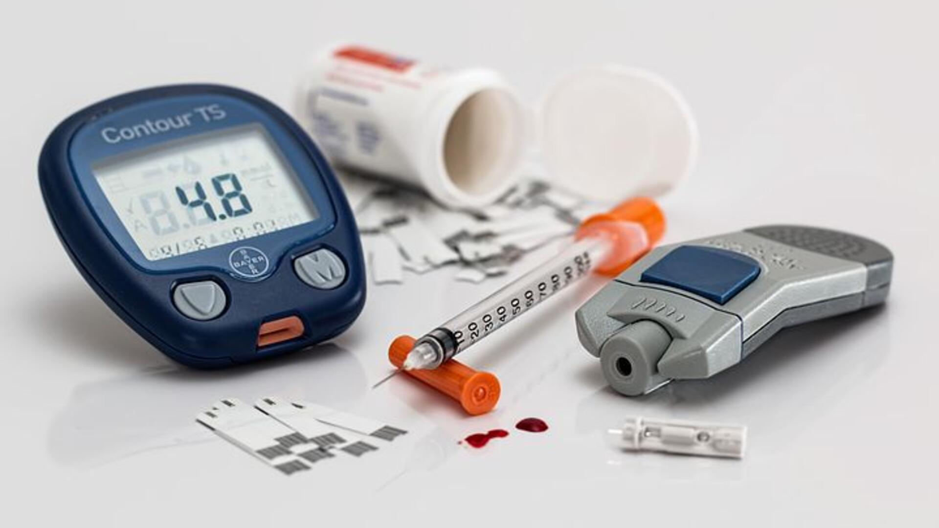 Stock image of diabetes medications and blood sugar testing machines.