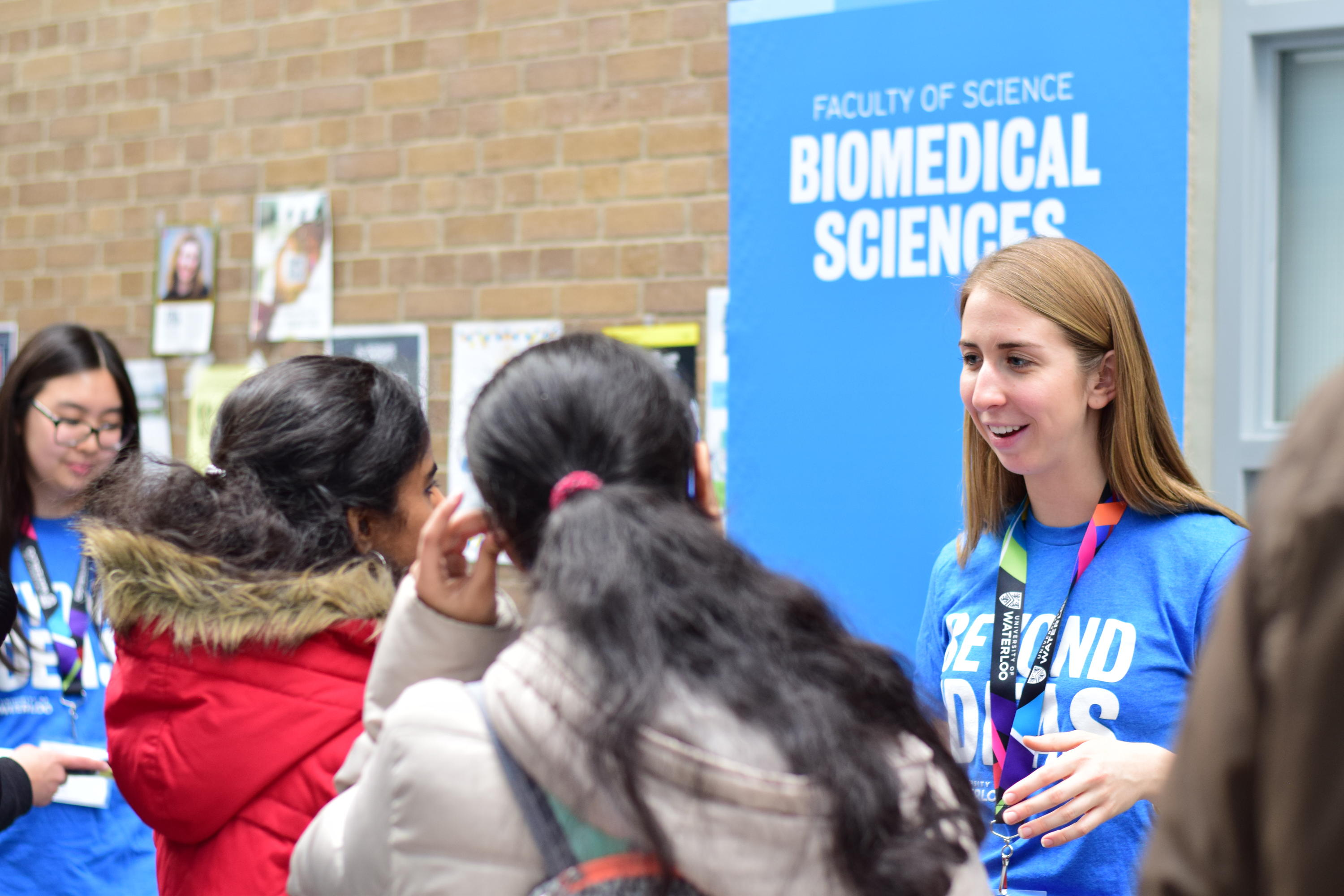 Science ambassador talking to prospective students at the fall open house.