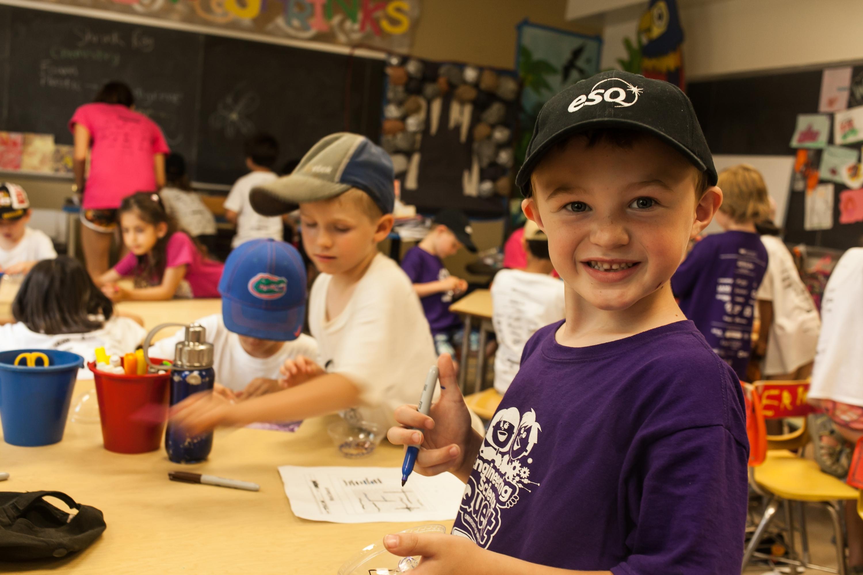 A Grade 1 to 2 camper enjoys ESQ in July 2013.