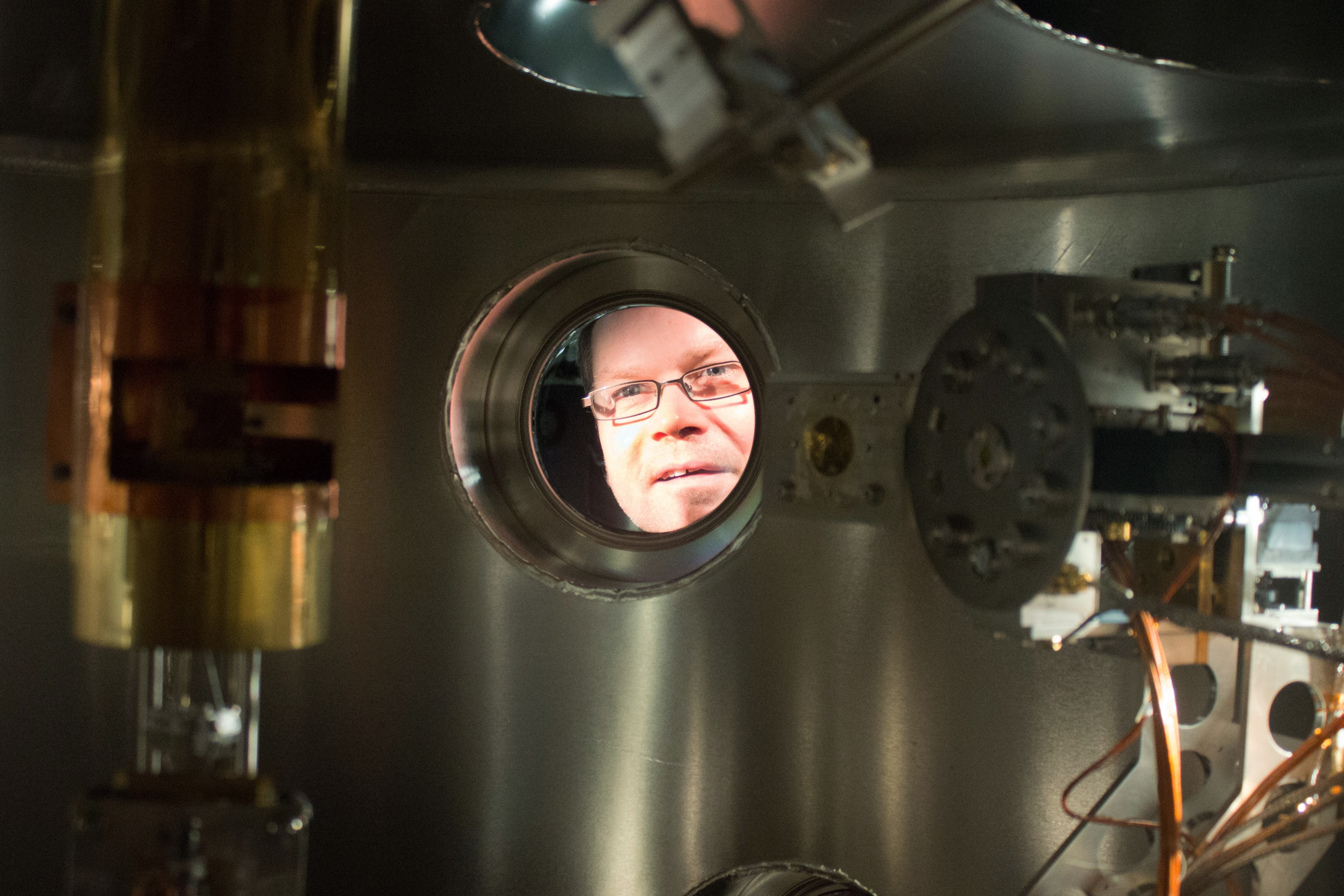 Professor David Hawthorn looks out through the resonant soft x-ray scattering instrument.