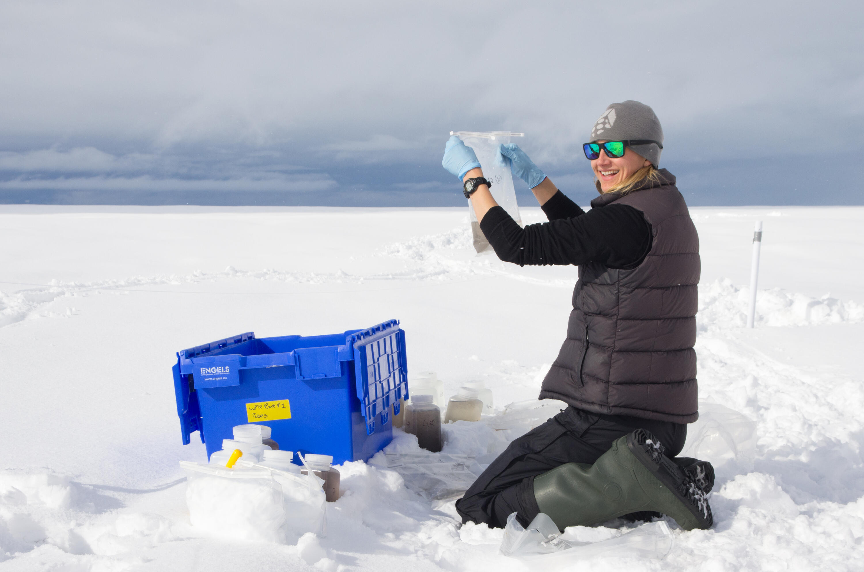 Jenine McCutcheon sampling snow on the Greenland Ice Sheet