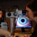 Craig Woods and Kathy Dumbleton conducting an eye experiment