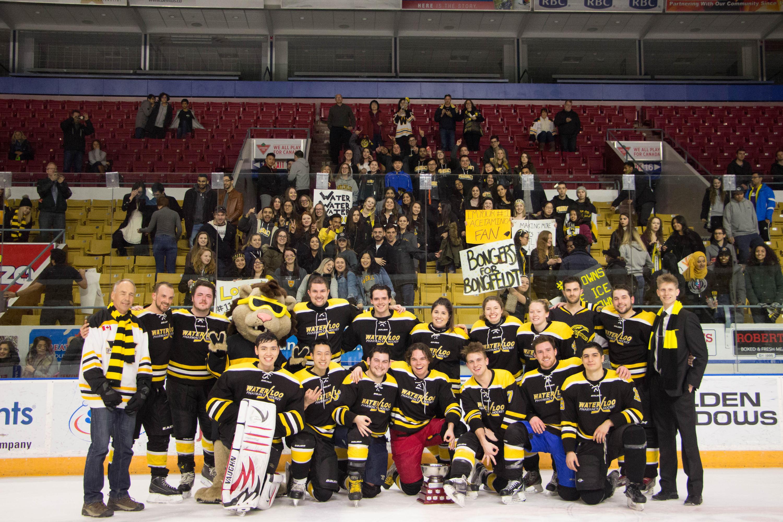 Waterloo Pharmacy hockey team with their fans