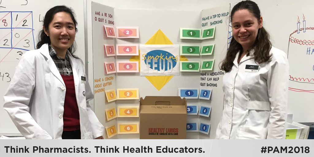 Two students in a school classroom. Think Pharmacists. Think Health Educators. #PAM2018.