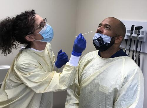 Dr. Stanberry receives a Panbio test in the Optometry Clinics