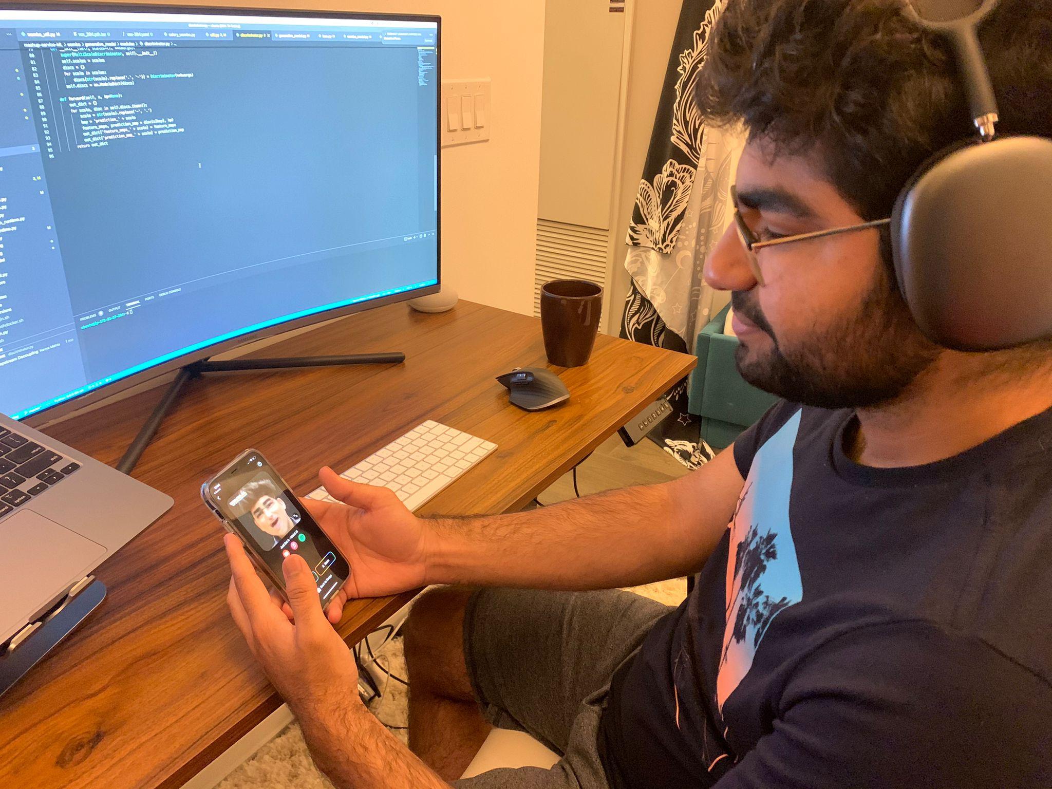 Parshant Utam using the Wombo app on his phone