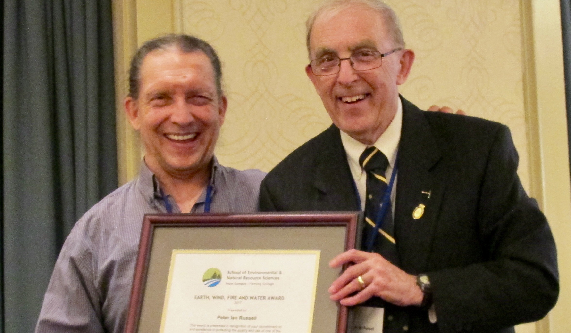 Bill Clarke and Peter Russel with framed award