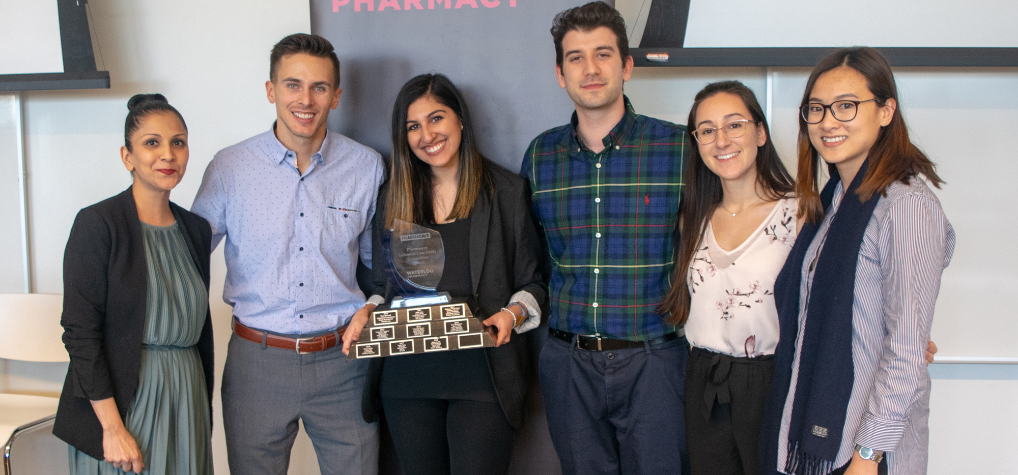 Jaspreet Dhaliwall with the students behind Oversees, Joey Champigny, Saara Manji, Arthur Catapano, Rebecca Conti, Lee Pham