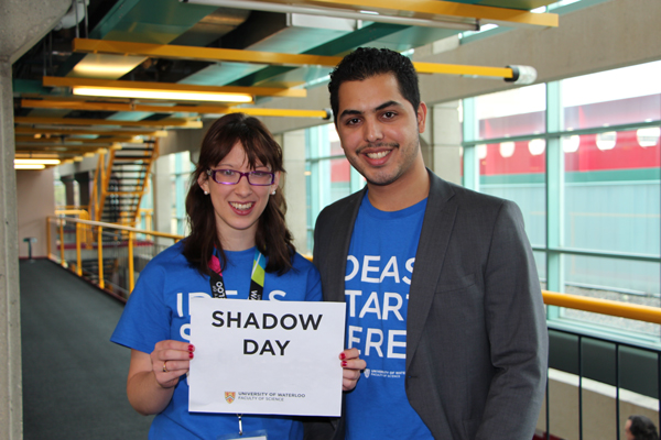 current students holding shadow day sign