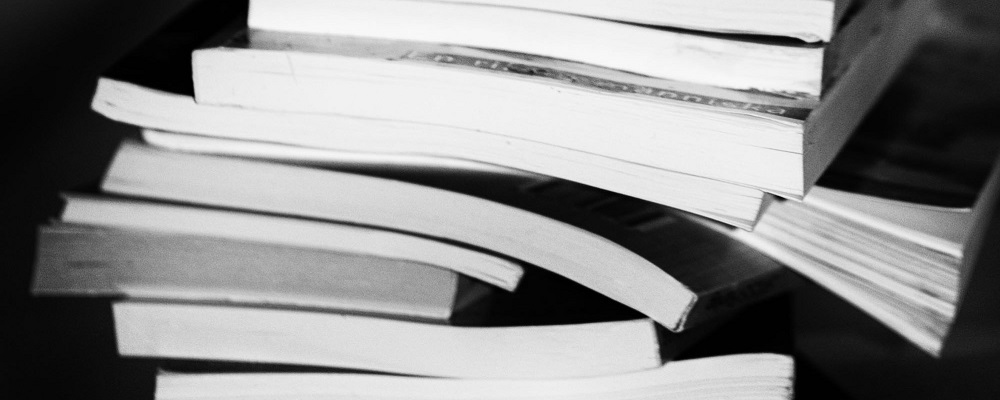 Black and white image of a stack of books