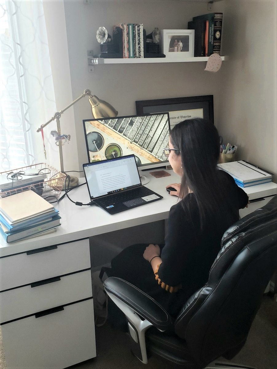grad student working at home office