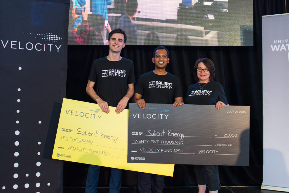 Salient Energy team with large cheques