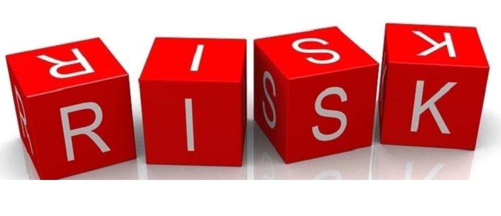 4 red Cubes each with a letter to read RISk