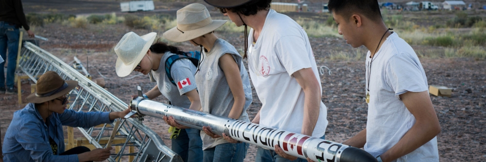 The Waterloo Rocketry Team prepares the rocket for liftoff in Utah