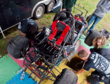 FASE team fixing a car
