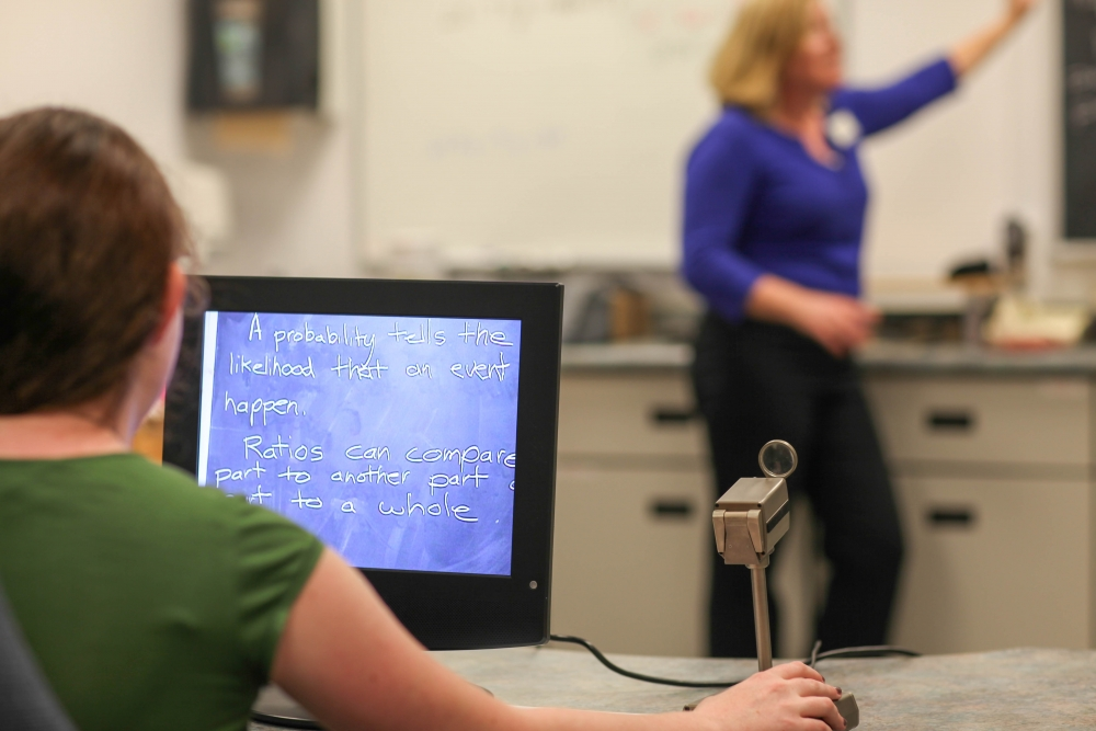 Student views text on a blackboard using a multifunction CCTV.