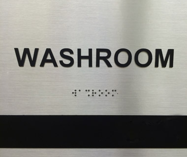 inclusive washroom sign