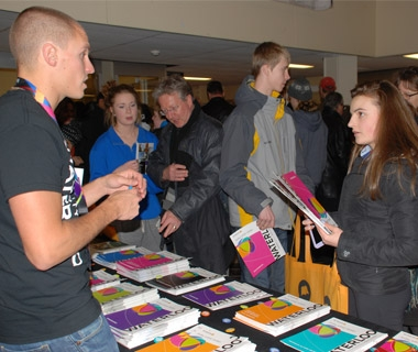 prospective student speaking to Waterloo representative at fair