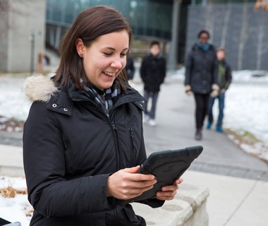 Woman checking tablet