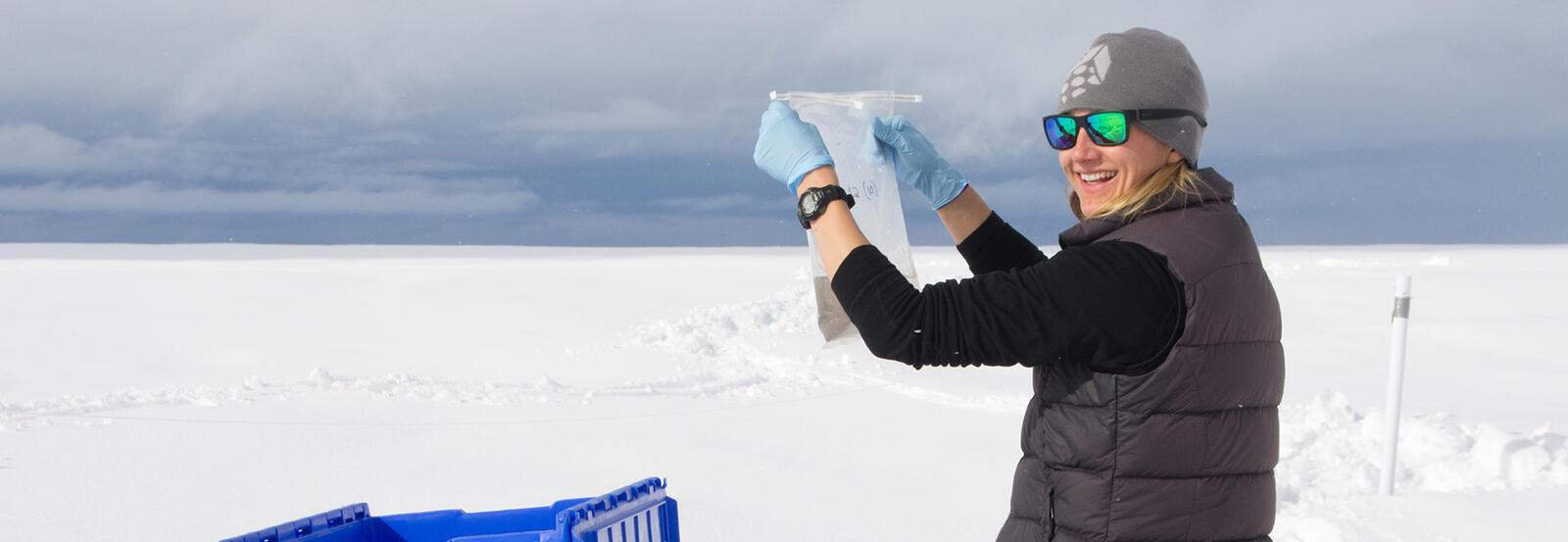 Professor Jenine McCutcheon sampling snow and ice on the Greenland Ice Sheet.