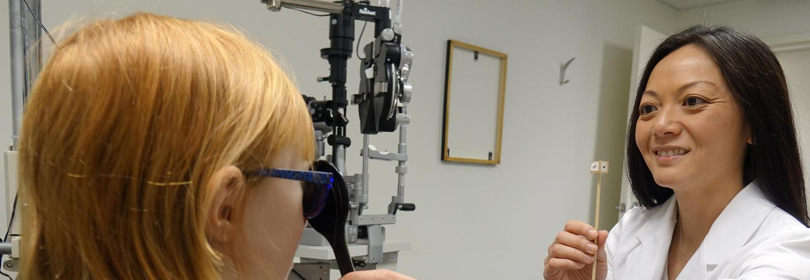 optometrist eye exam  with a child