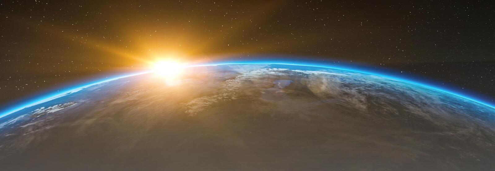 Sun rising over Earth.