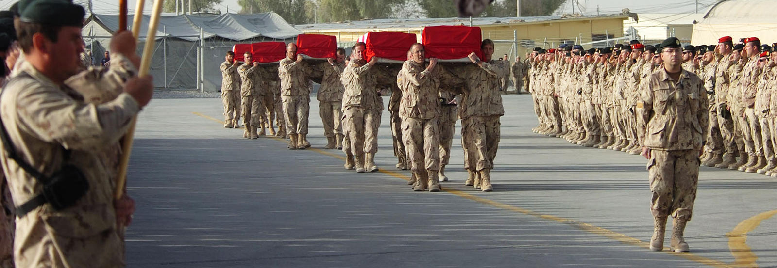 soldiers carrying coffins