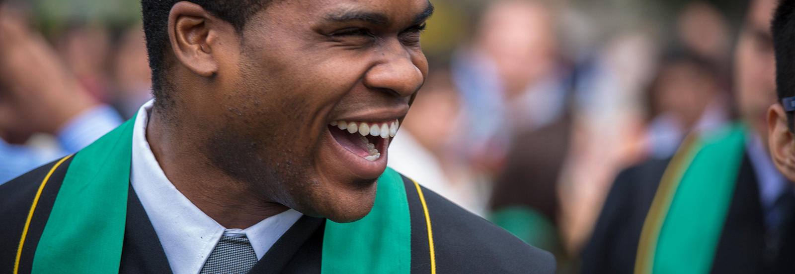 male student smiling at convocation