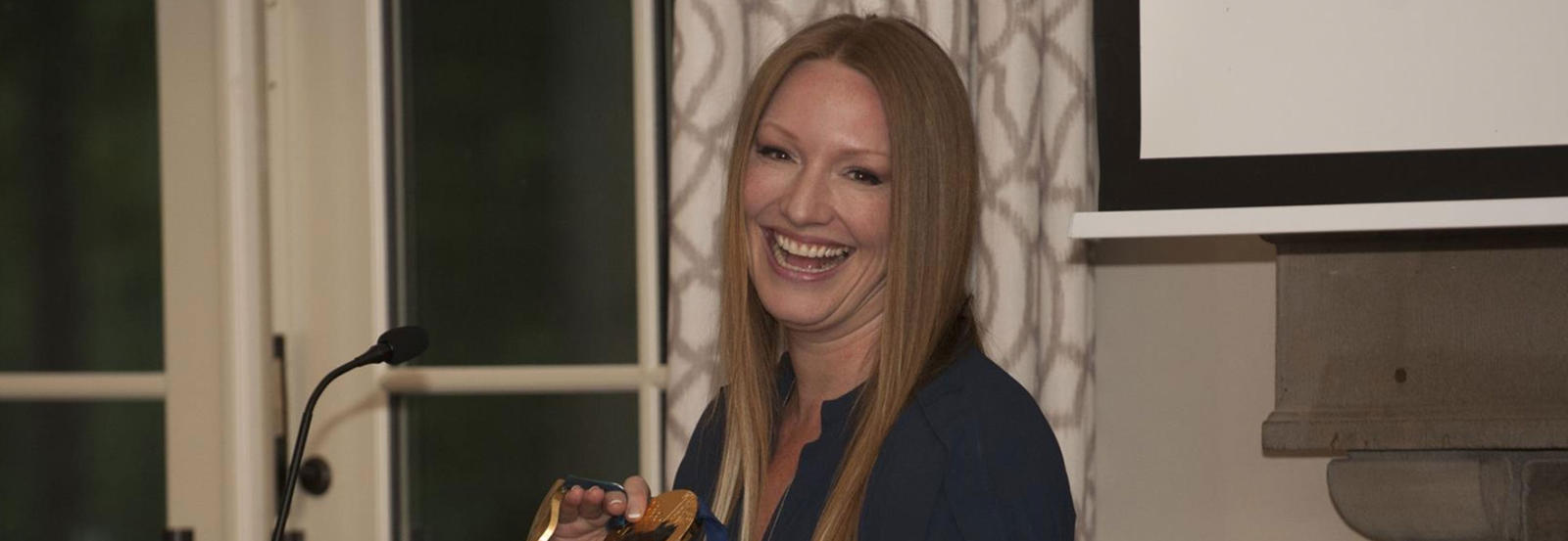 Heather Moyse holds up her Olympic medal.