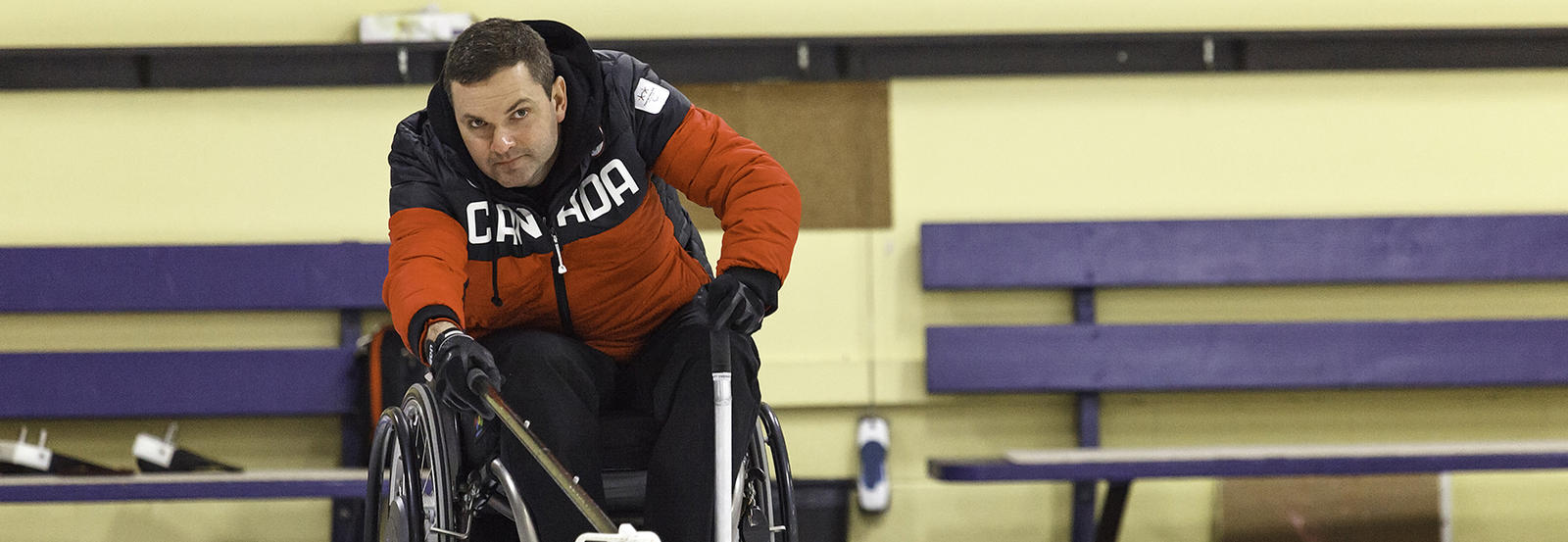 Mark Ideson, skip of the Team Canada wheelchair curling team, takes a shot using the Mark 7 device named in his honour.