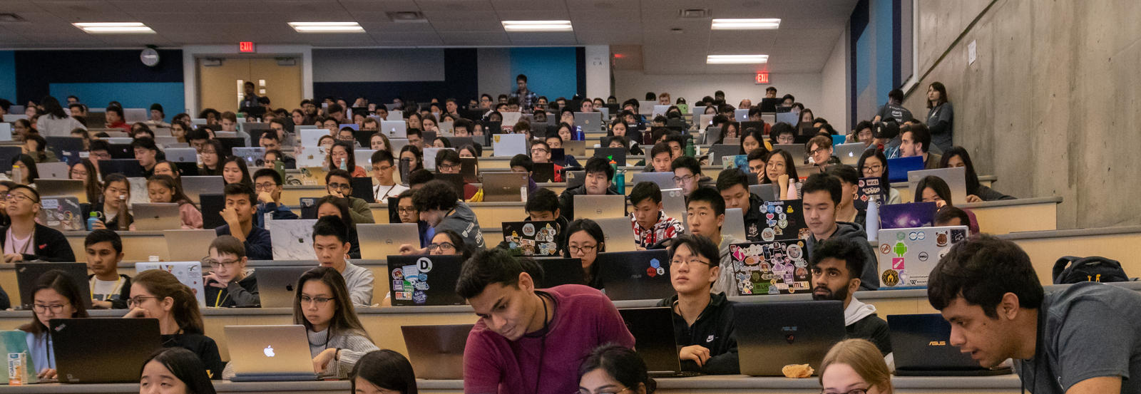 Students in lecture hall with laptops