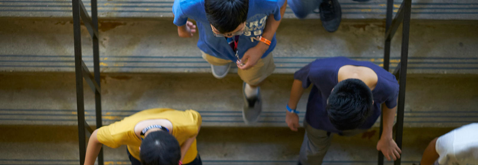 Aerial view of students walking down stairs