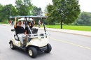 Waterloo president and student innovator ride in a self-driving vehicle