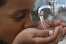 African child drinking clean water
