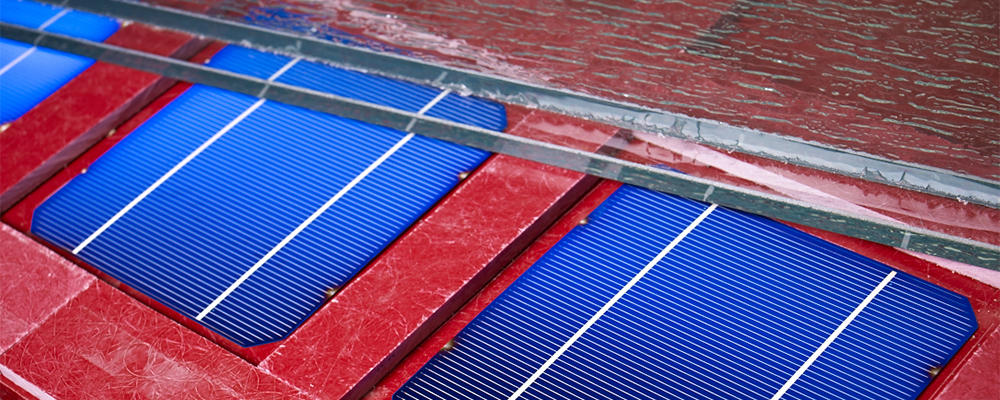Blue solar panels with red backing and glass on top