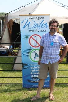 Rob Case in front of Water Watchers display.