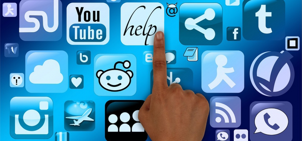 Hand points at social media icons
