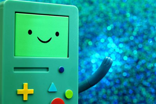 image of gameboy system with a smile on the screen.