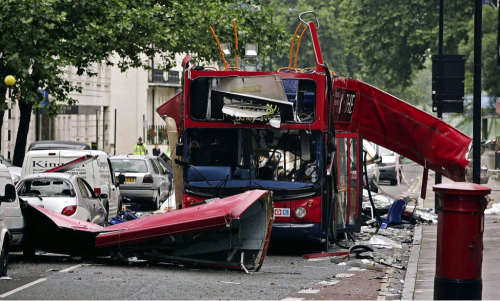 picture of destroyed double-decker bus.