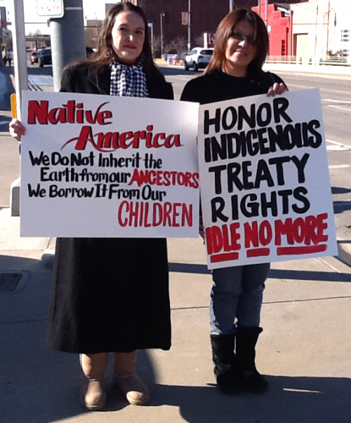 Two Native American protesters at an Idle No More round dance.
