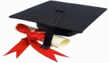 Picture of diploma scroll and graduation hat
